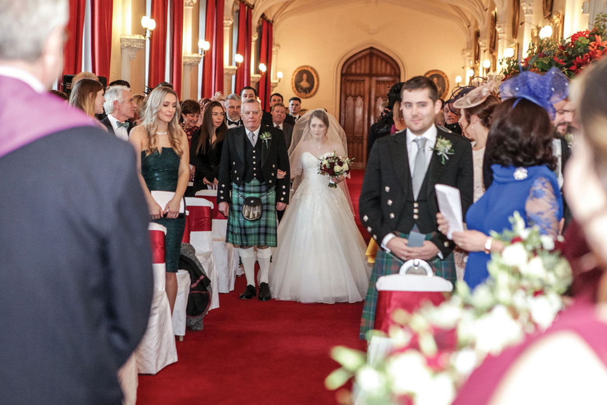 bride-walking-up-the-aisle-at-scone-palace