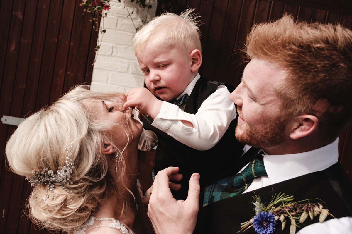 bride-and-groom-with-their-son