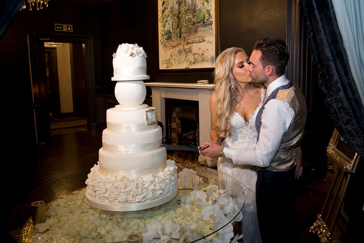 bride-and-groom-cutting-tall-cake