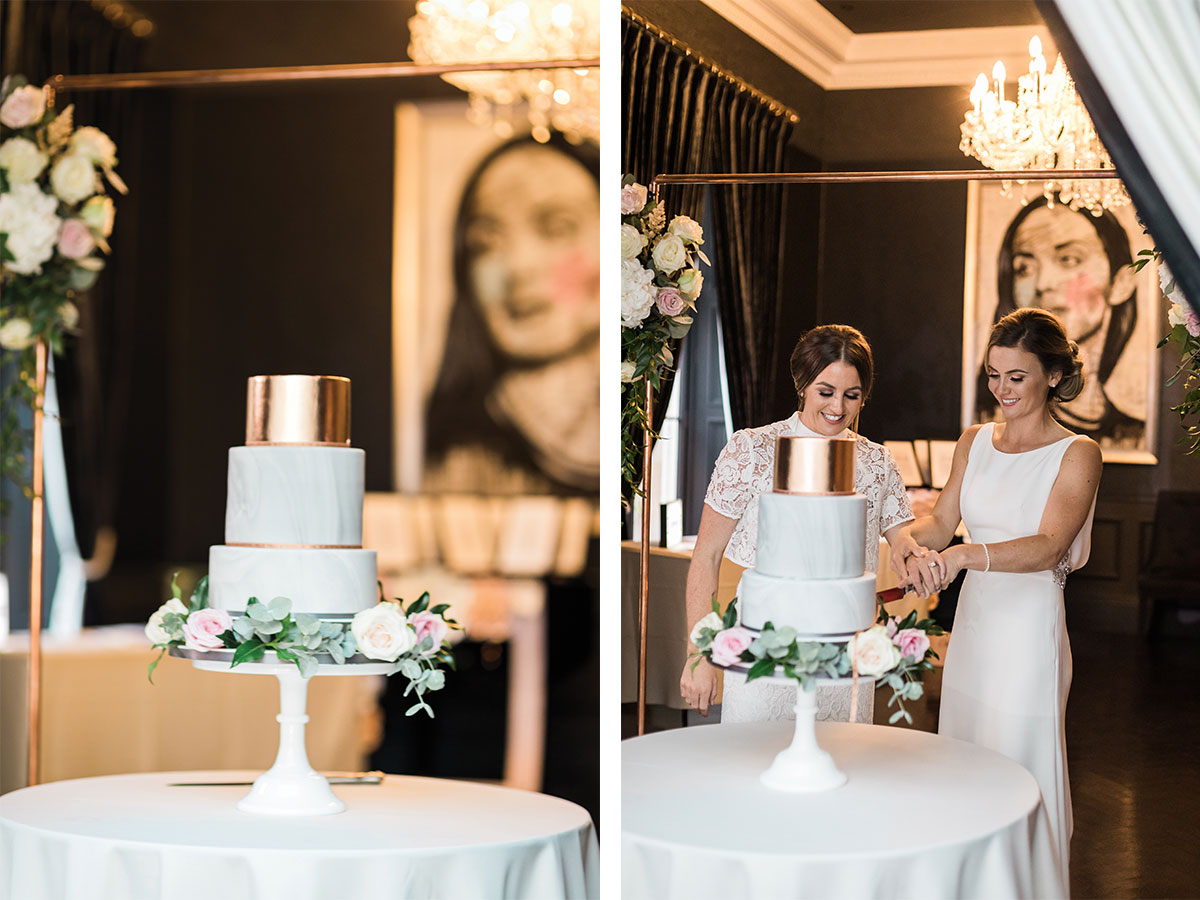 copper-and-marble-wedding-cake-behind-copper-wire-arch