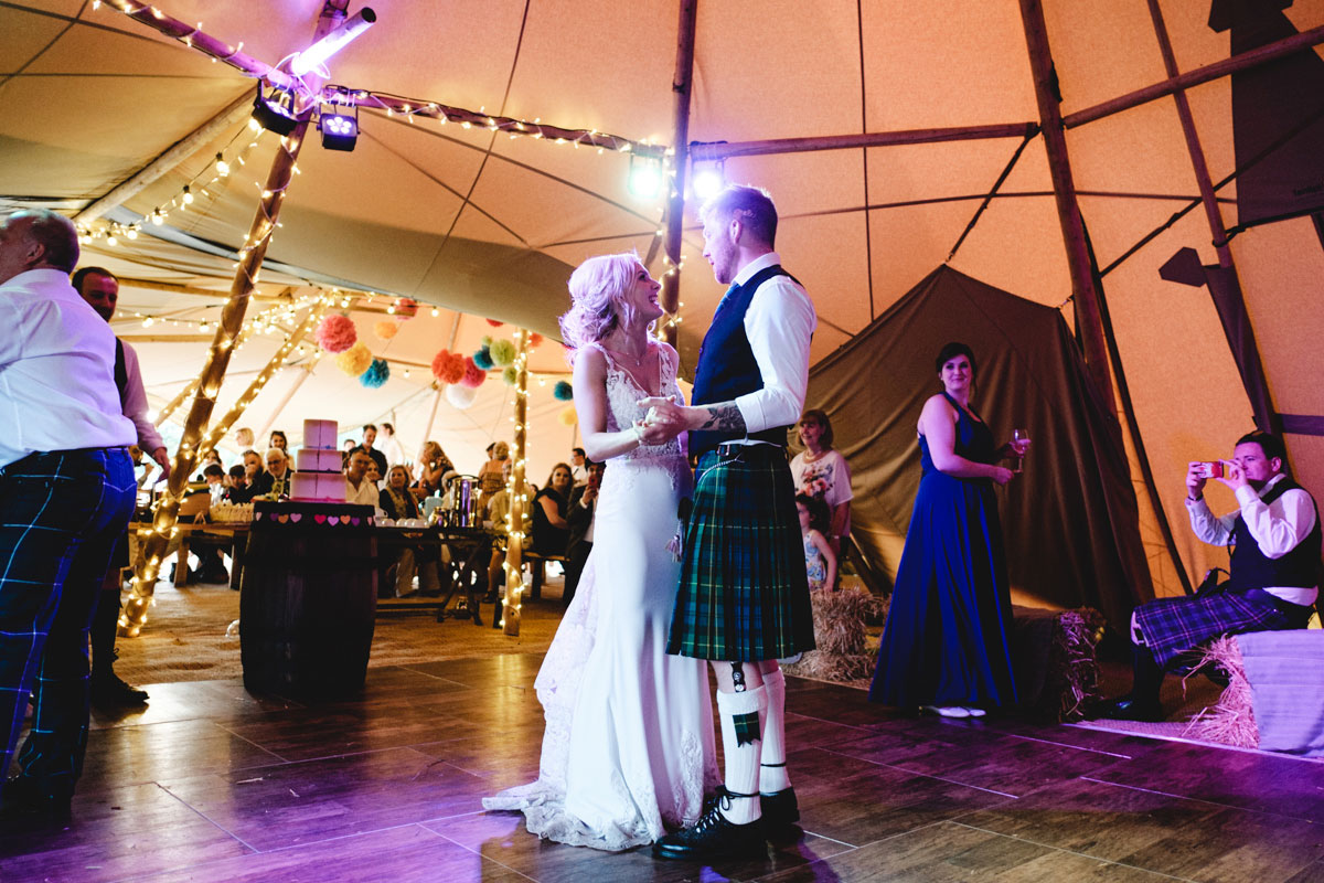 first-dance-in-a-teepee-with-purple-lighting
