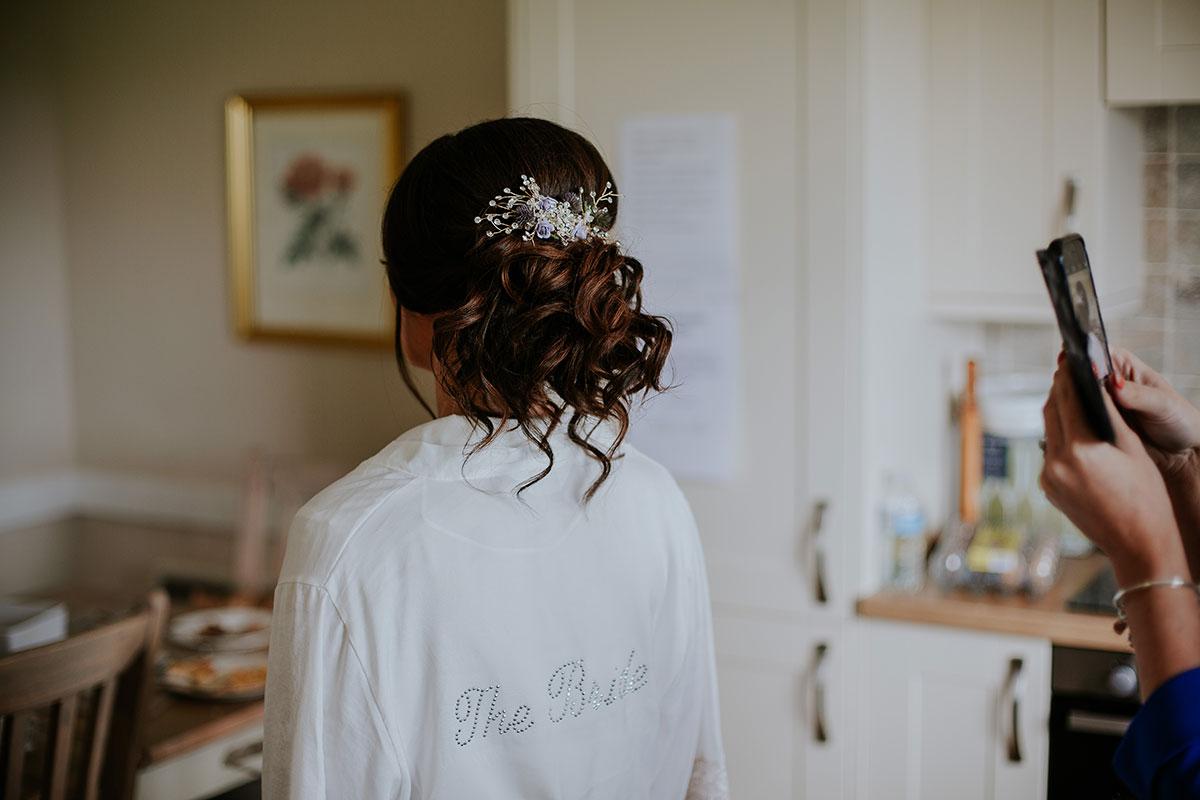 bride-wearing-white-silk-robe