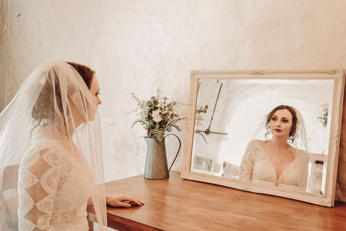 bride-looking-in-ornate-mirror