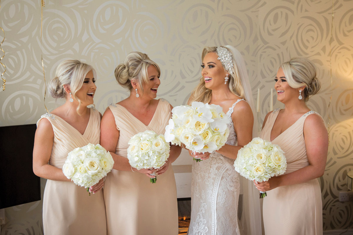 bride-and-bridesmaids-in-pastel-dresses