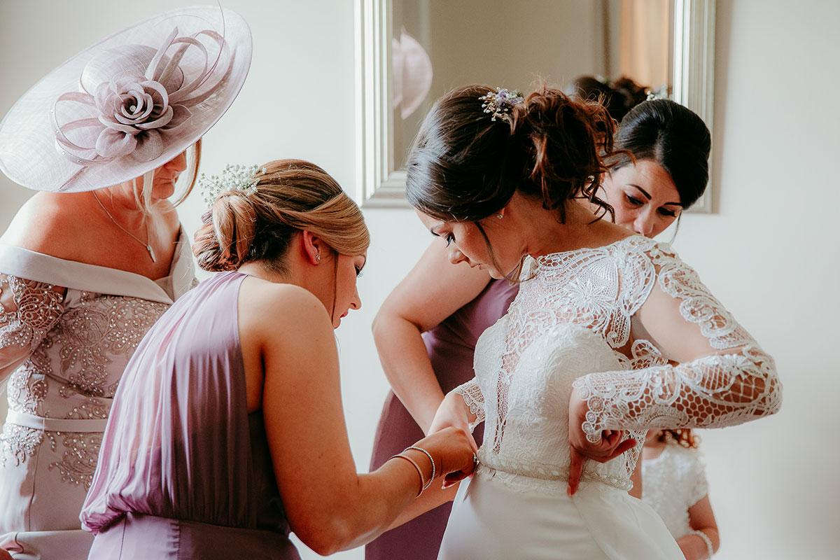 bridesmaids-fixing-the-brides-dress