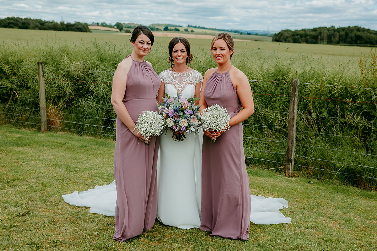 bride-and-bridesmaids-in-lilac-dresses