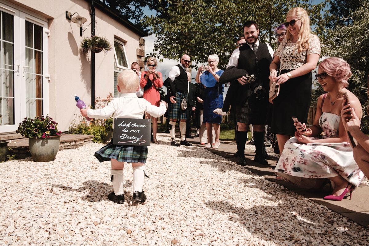 toddler-wearing-personalised-wedding-sign