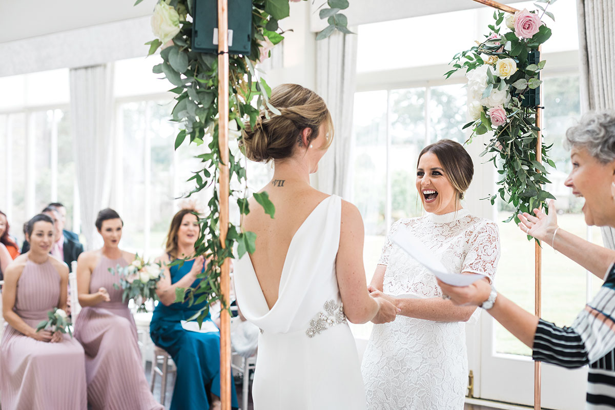 the-brides-laughing-during-the-ceremony