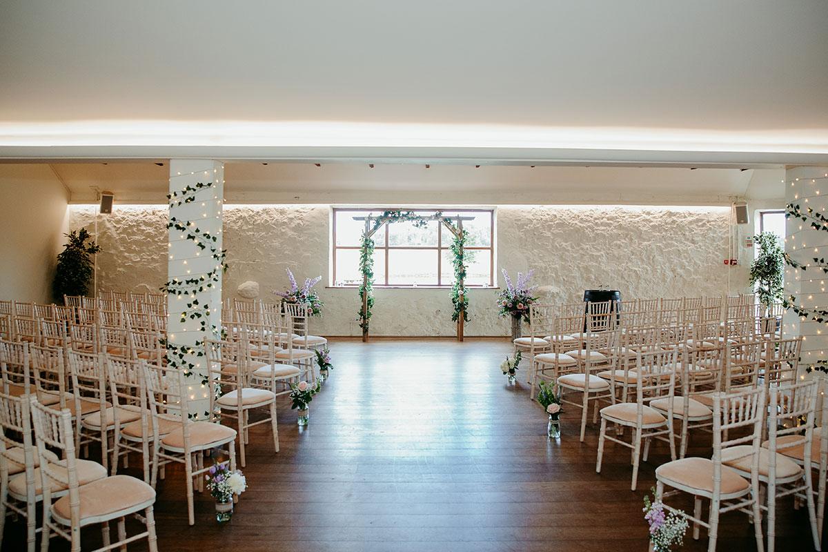 white-barn-set-up-for-wedding-ceremony