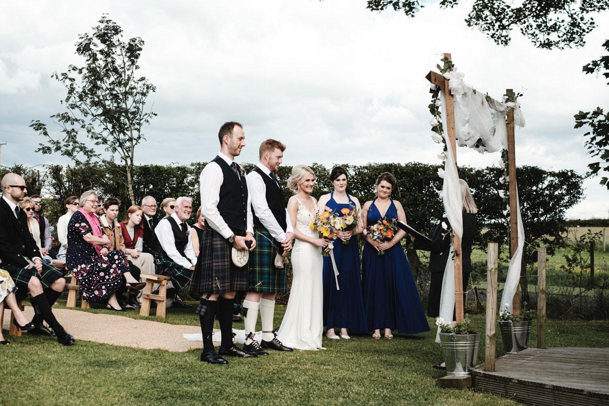 bride-and-groom-having-outdoor-ceremony