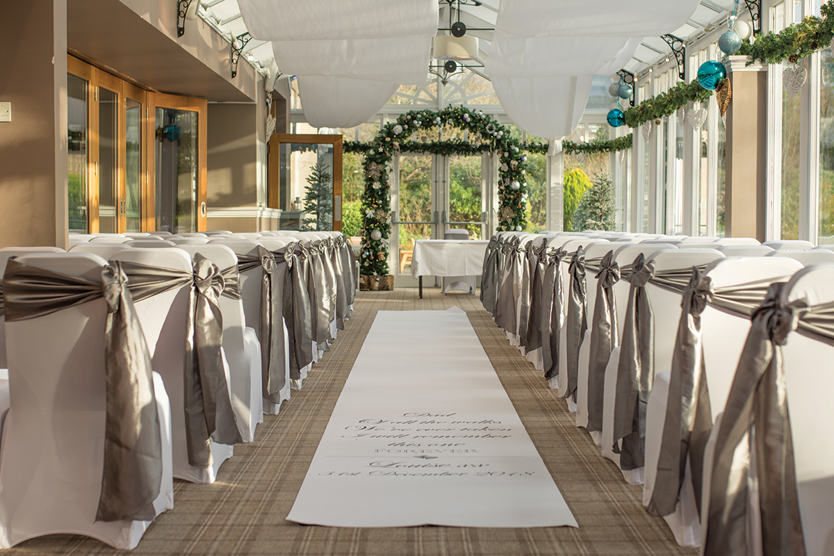 rosslea-house-hotel-ceremony-room-with-aisle-runner-and-chair-covers