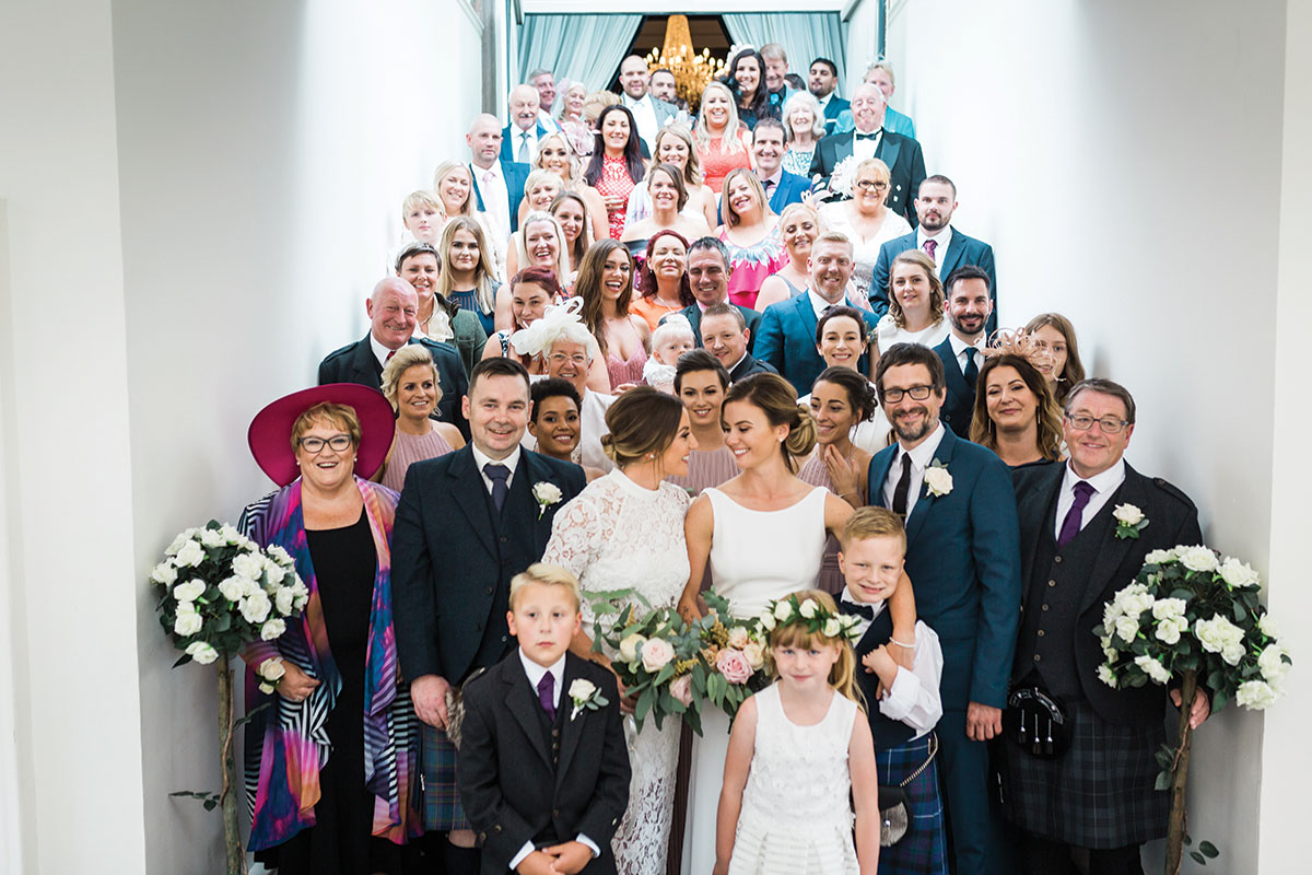 all-the-wedding-guests-on-the-stairs-into-the-function-room