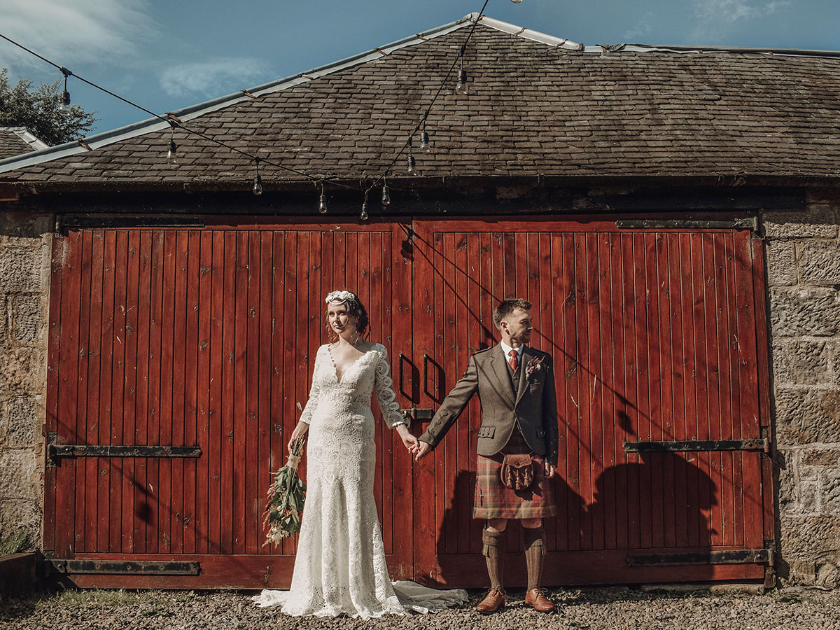 bride-and-groom-in-front-of-barn-doors