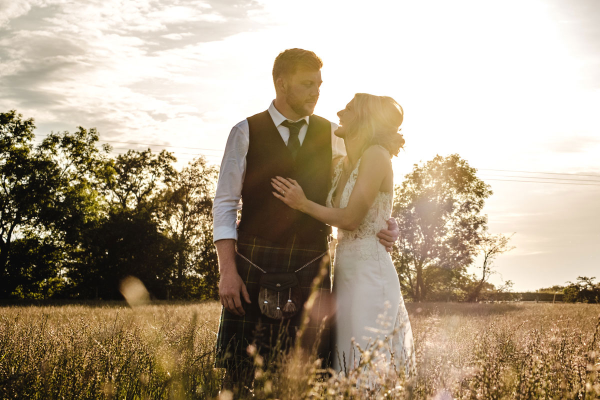 bride-and-groom-in-wheat-field