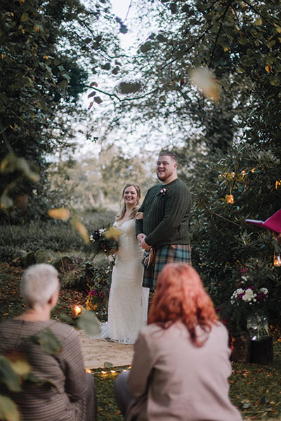 bride-and-groom-standing-at-the-top-of-the-aisle