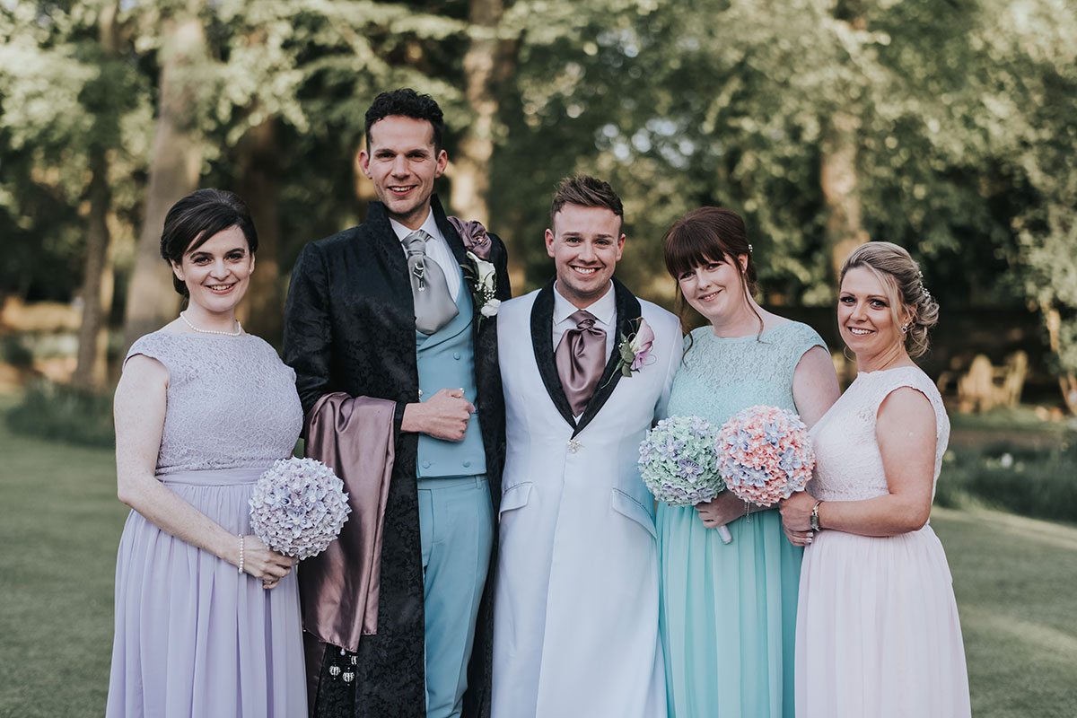 grooms-and-bridesmaids-in-pastel-dresses