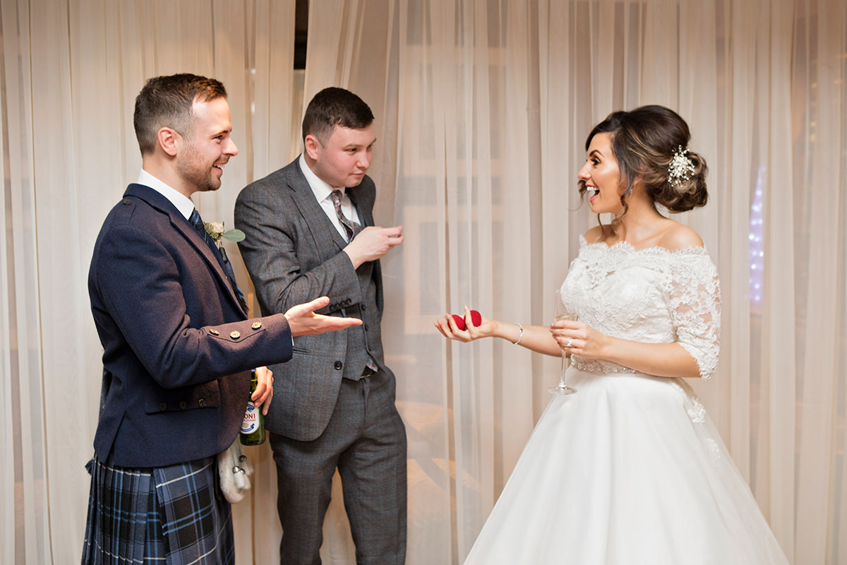 magician-performing-a-trick-for-the-bride-and-groom