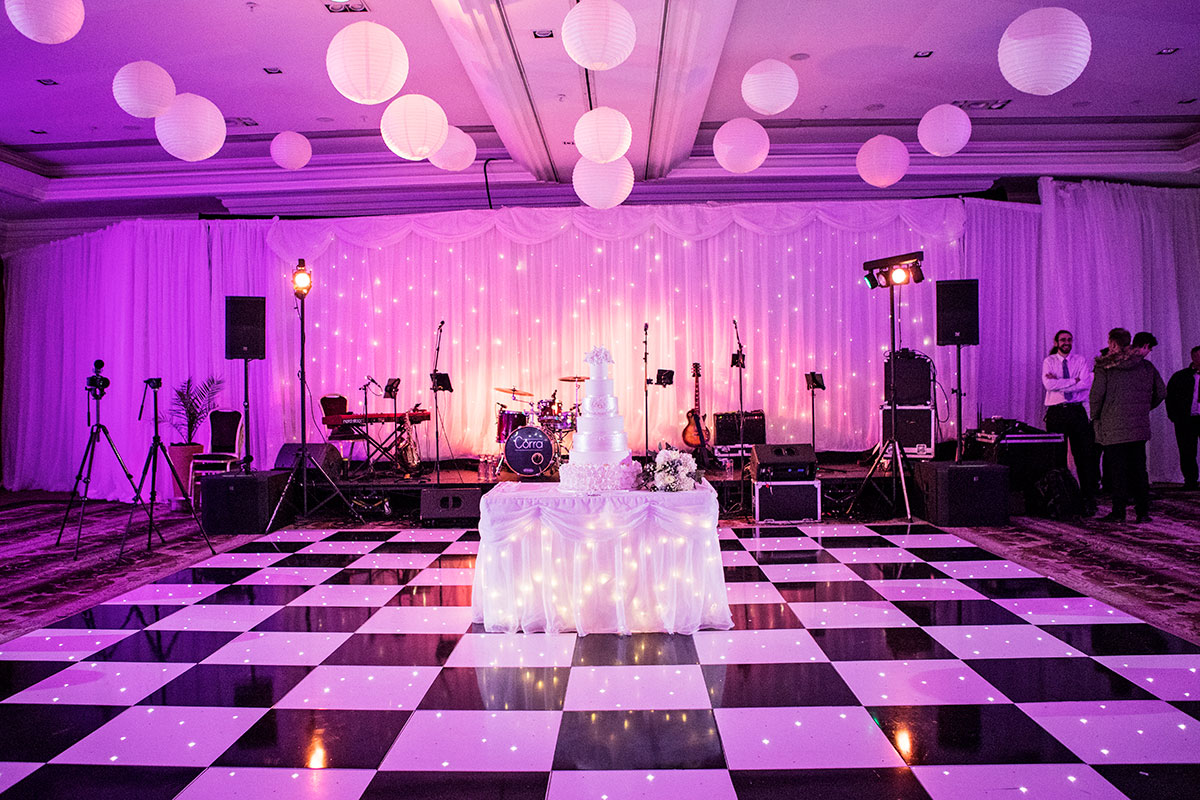 wedding-cake-on-table-on-monochrome-dancefloor
