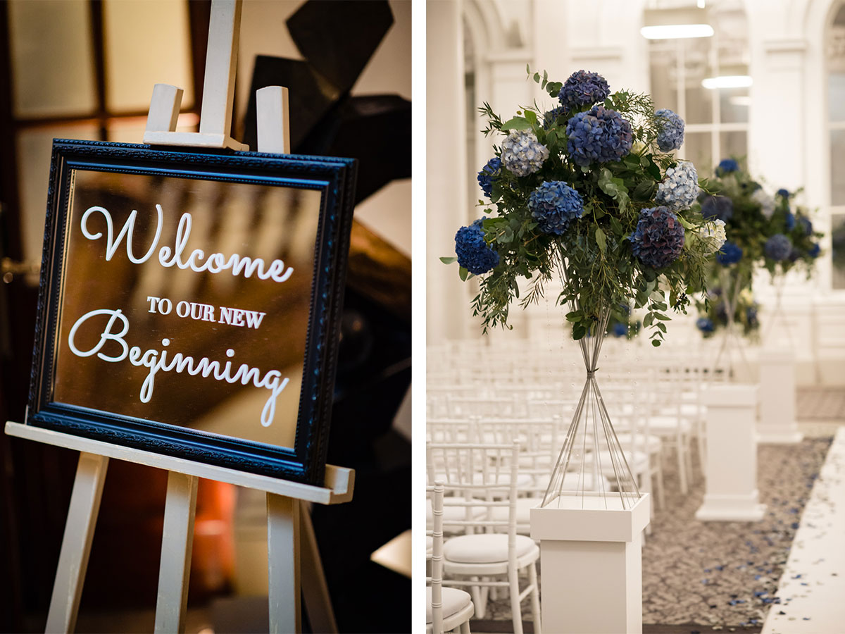 blue-floral-centrepiece-and-personalised-wedding-sign