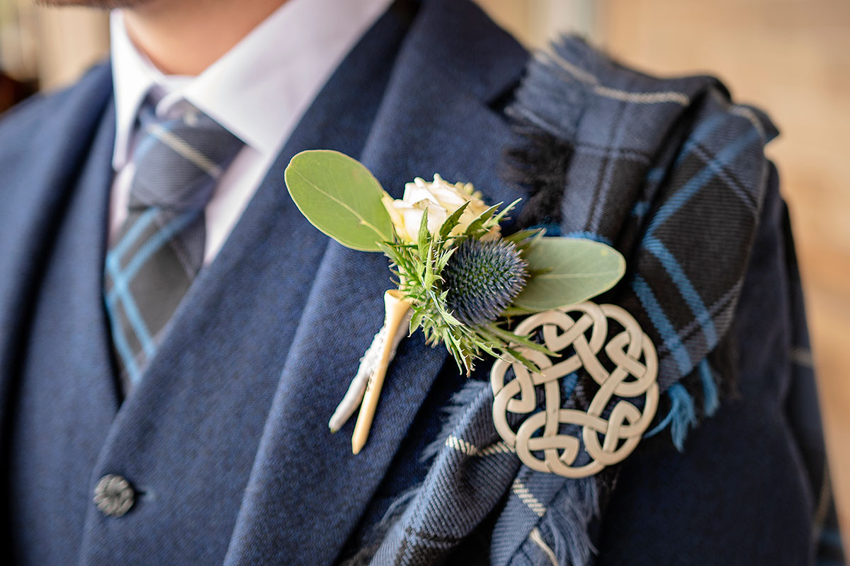 grooms-navy-tweed-kilt-outfit-with-thistle-buttonhole