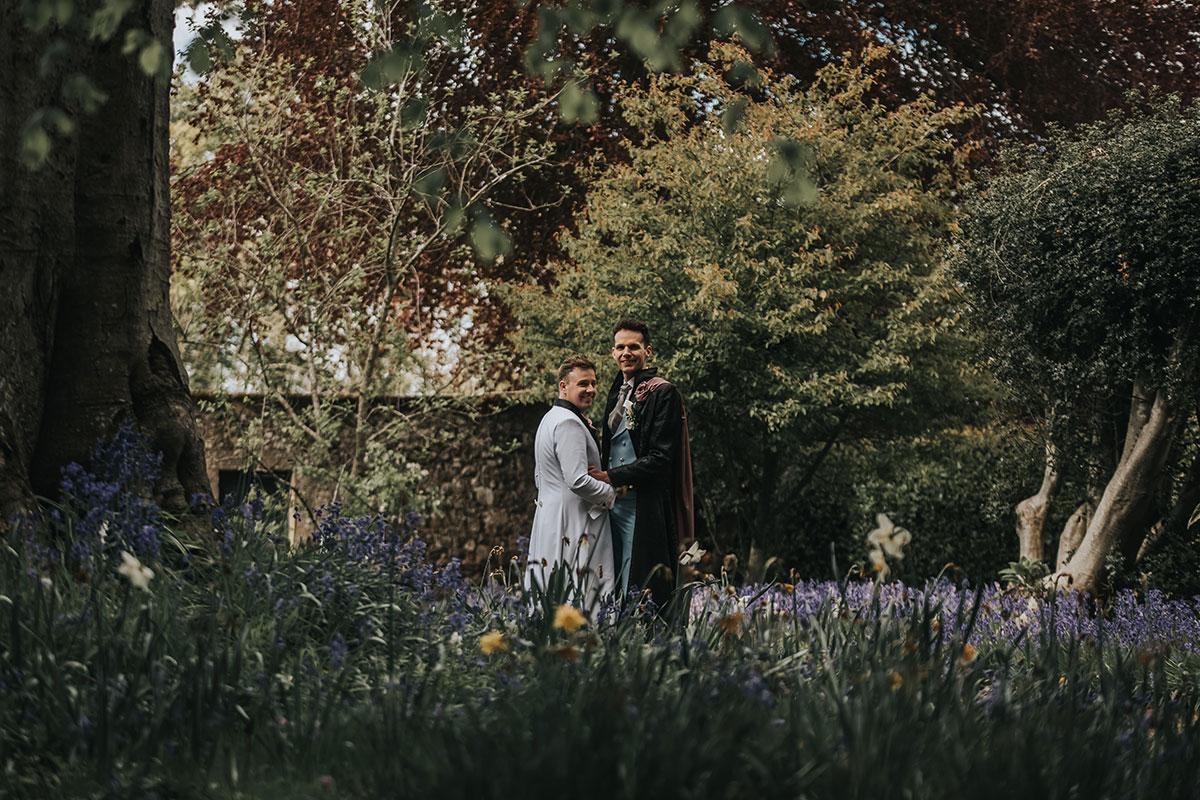 couple-posing-in-flower-garden