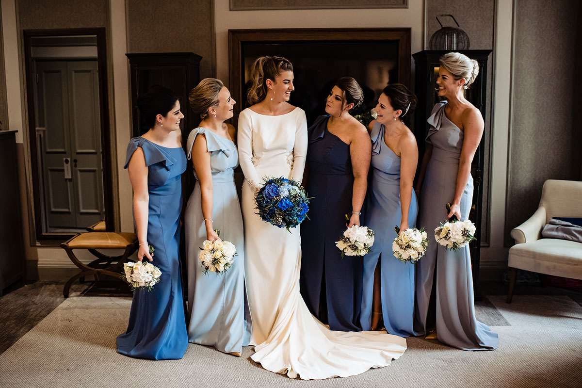 bride-and-bridesmaids-in-different-colours-of-blue-dresses