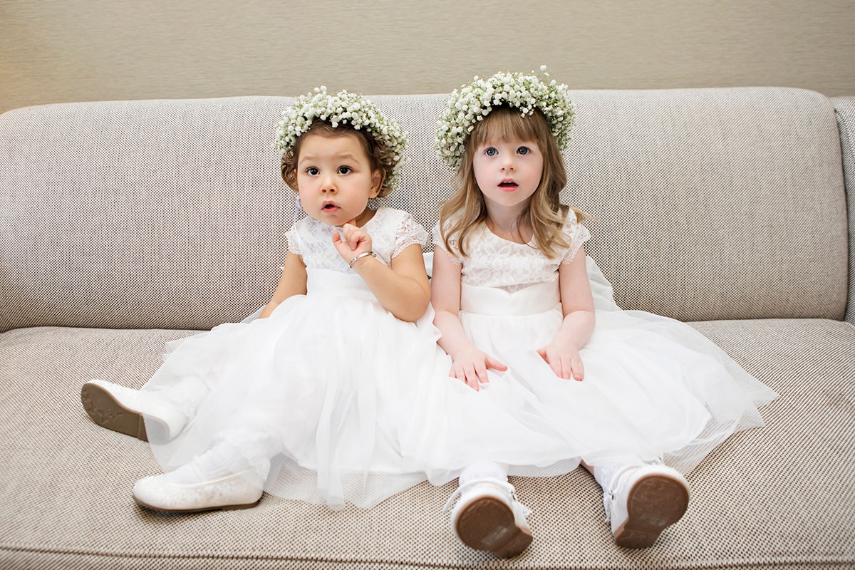 flowergirls-in-white-dresses-and-babys-breath-crowns