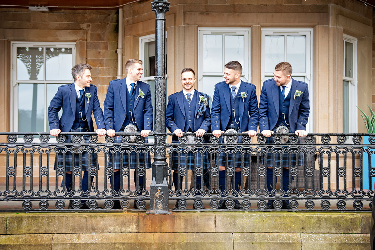 groom-and-groomsmen-in-matching-navy-tweed-kilt-outfits