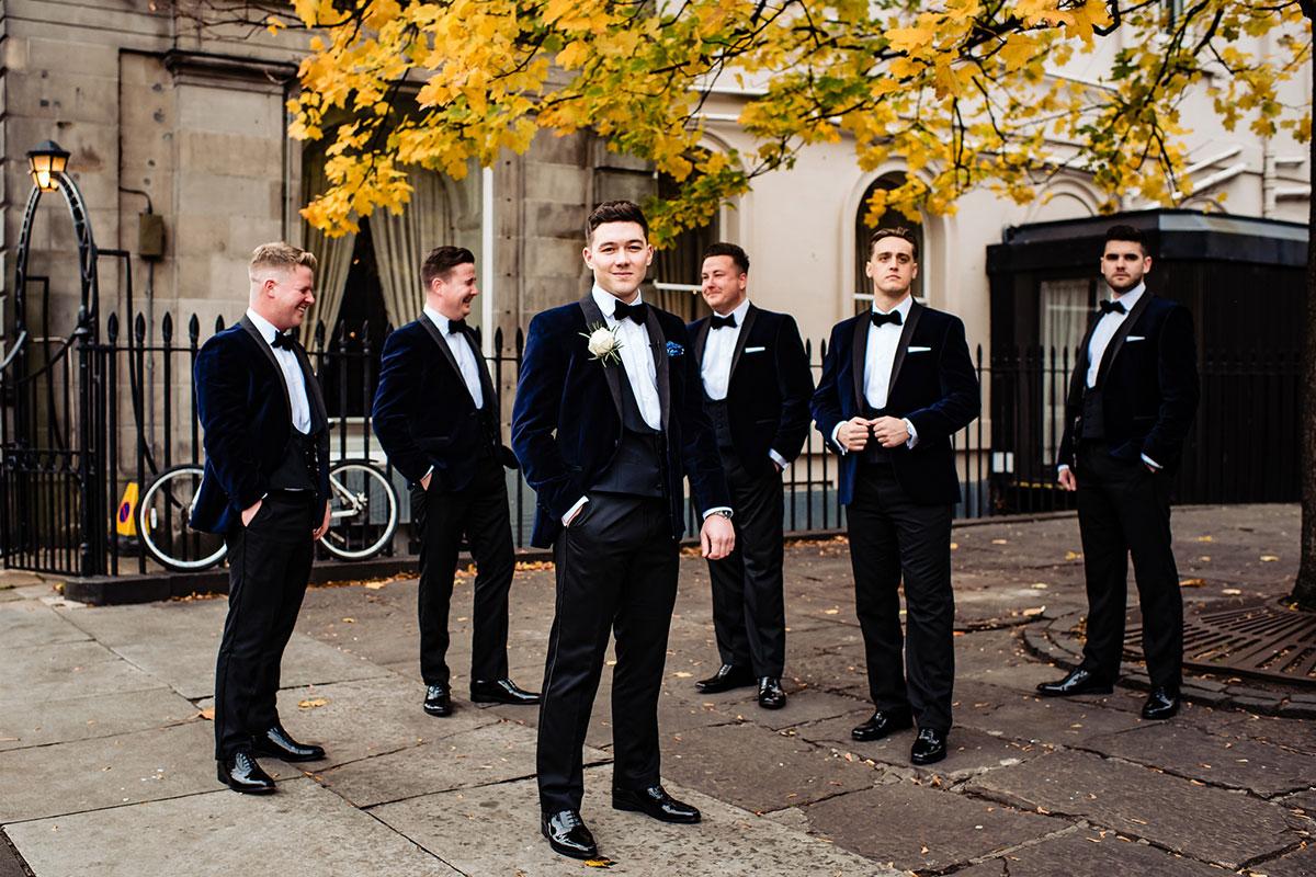 groom-and-groomsmen-in-navy-suits