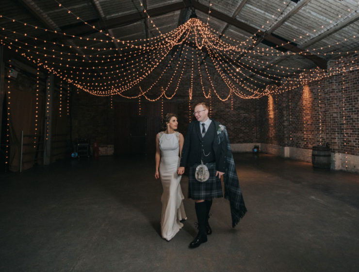bride-and-groom-in-main-room-at-kinkell-byre-wedding-venue