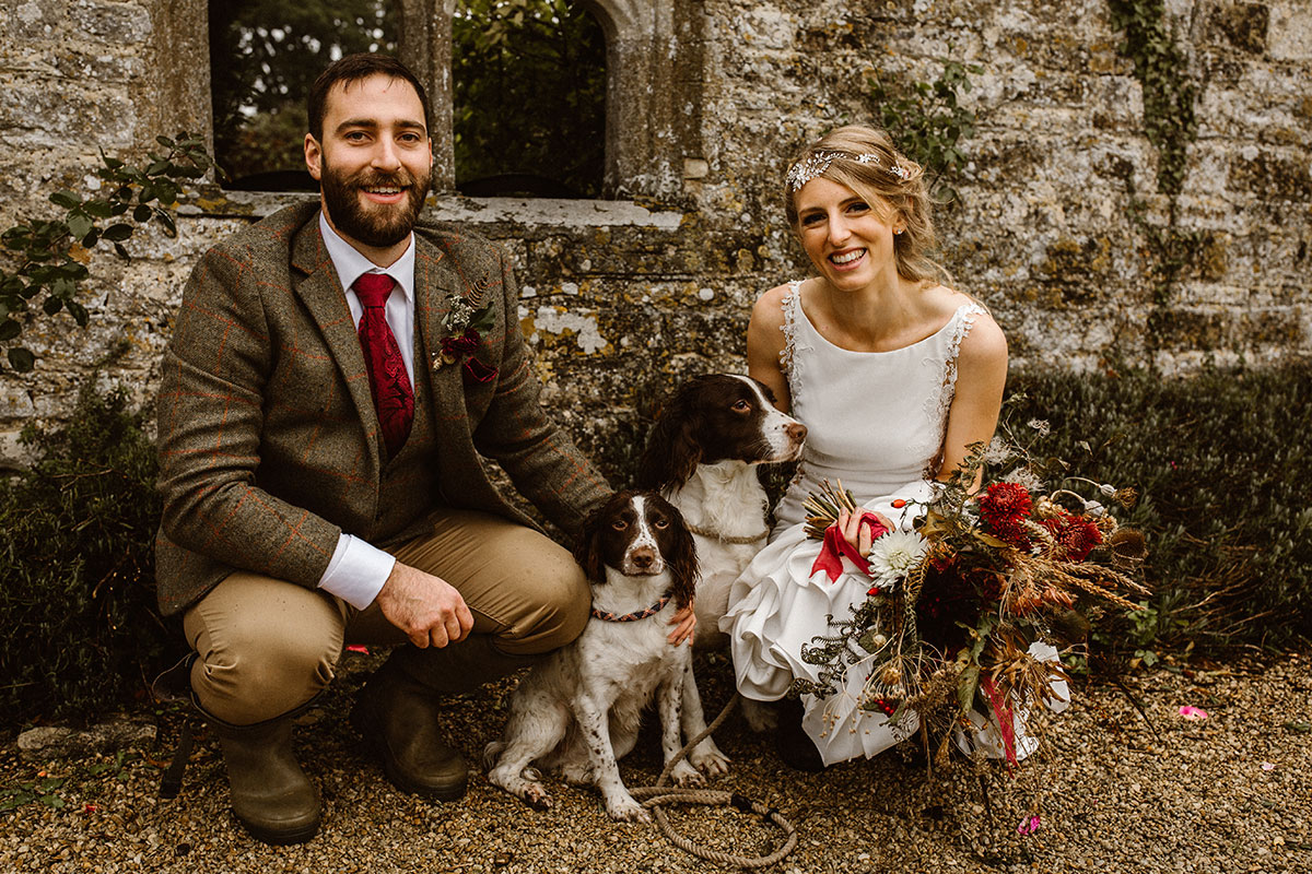 rustic-picture-of-bride-and-groom-with-two-dogs