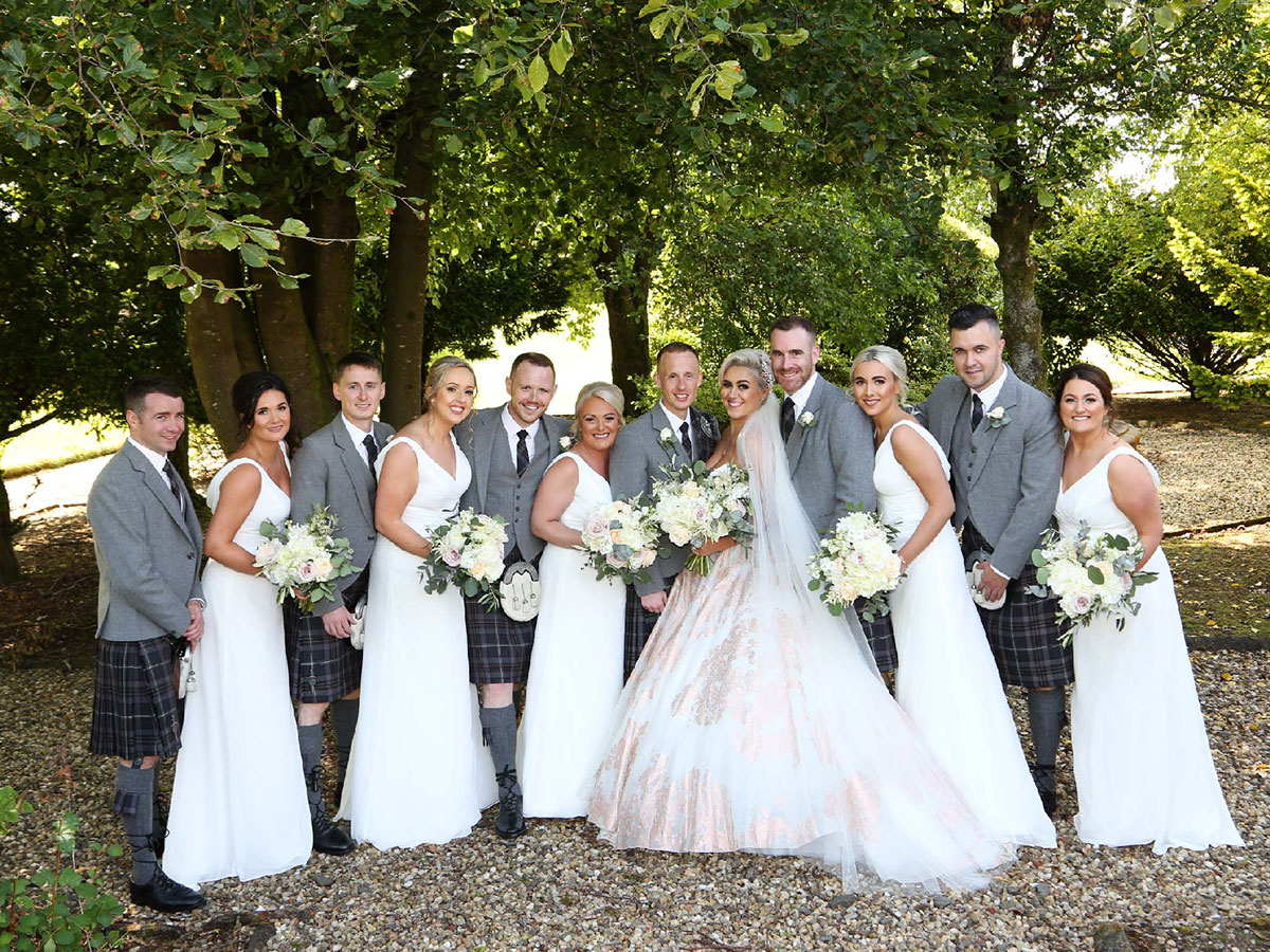 bridal-party-in-grey-kilt-outfits-and-pink-bridesmaids-dresses
