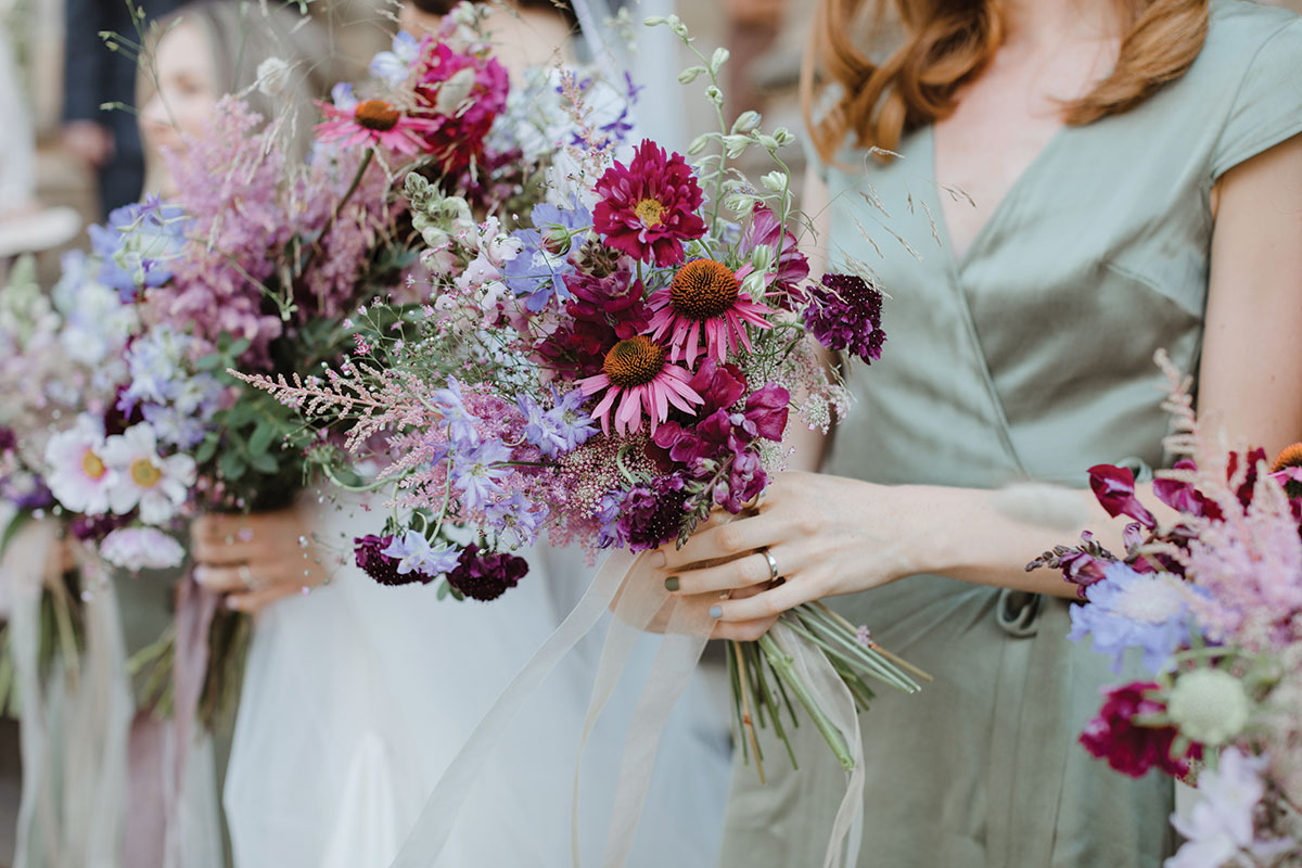 pink-bridal-bouquets-held-by-bridesmaids