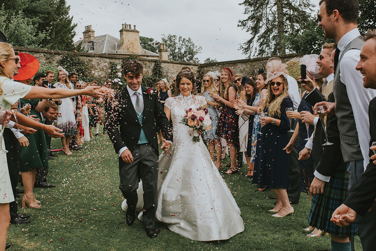 bride-and-groom-having-confetti-thrown-on-them