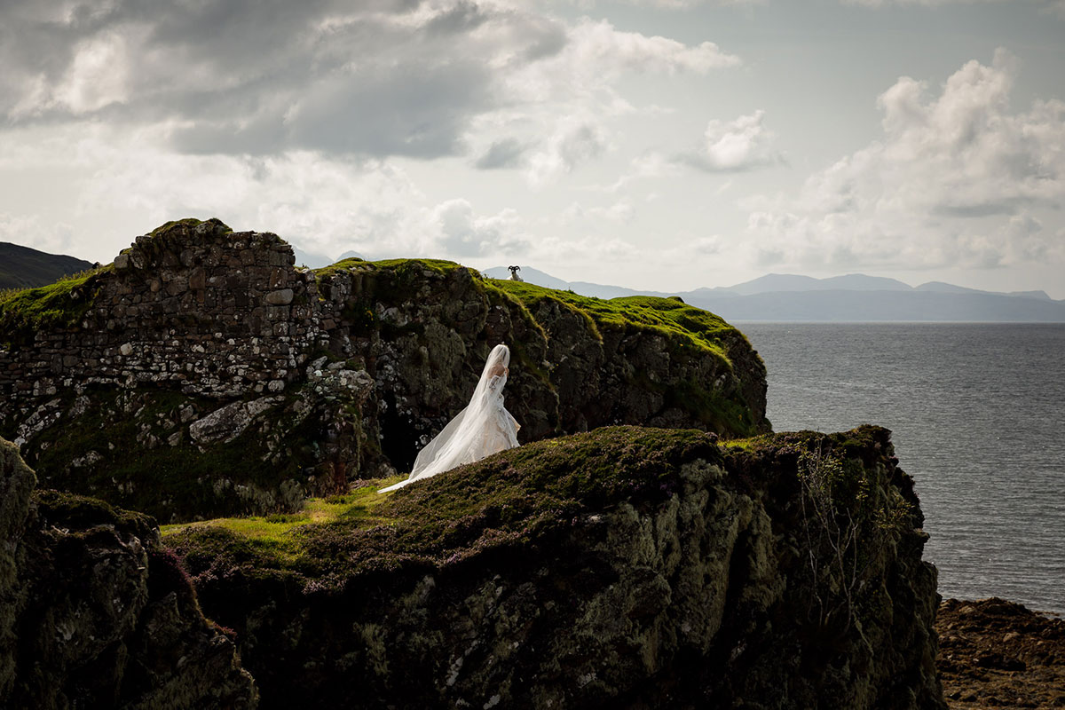bride-walking-along-cliffside