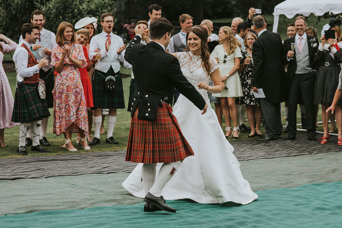 bride-and-groom-dancing-outside