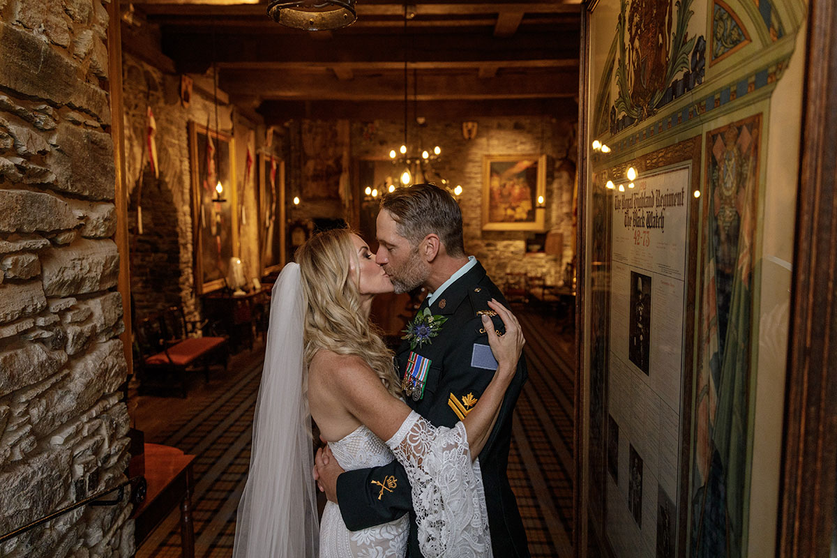 bride-and-groom-kissing-inside-castle