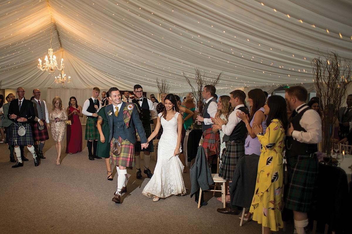 bride-and-groom-entering-dancefloor-for-first-dance