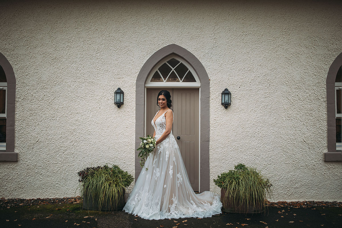 bride-in-front-of-doorway