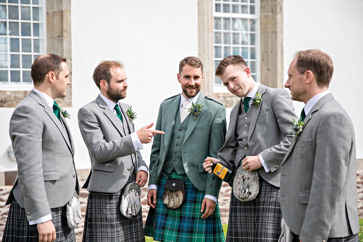 groom-and-groomsmen-with-bottle-of-buckfast