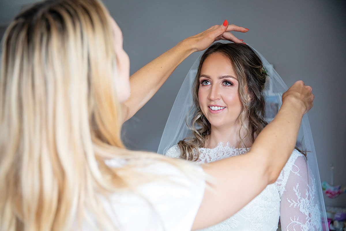 bride-having-veil-put-on