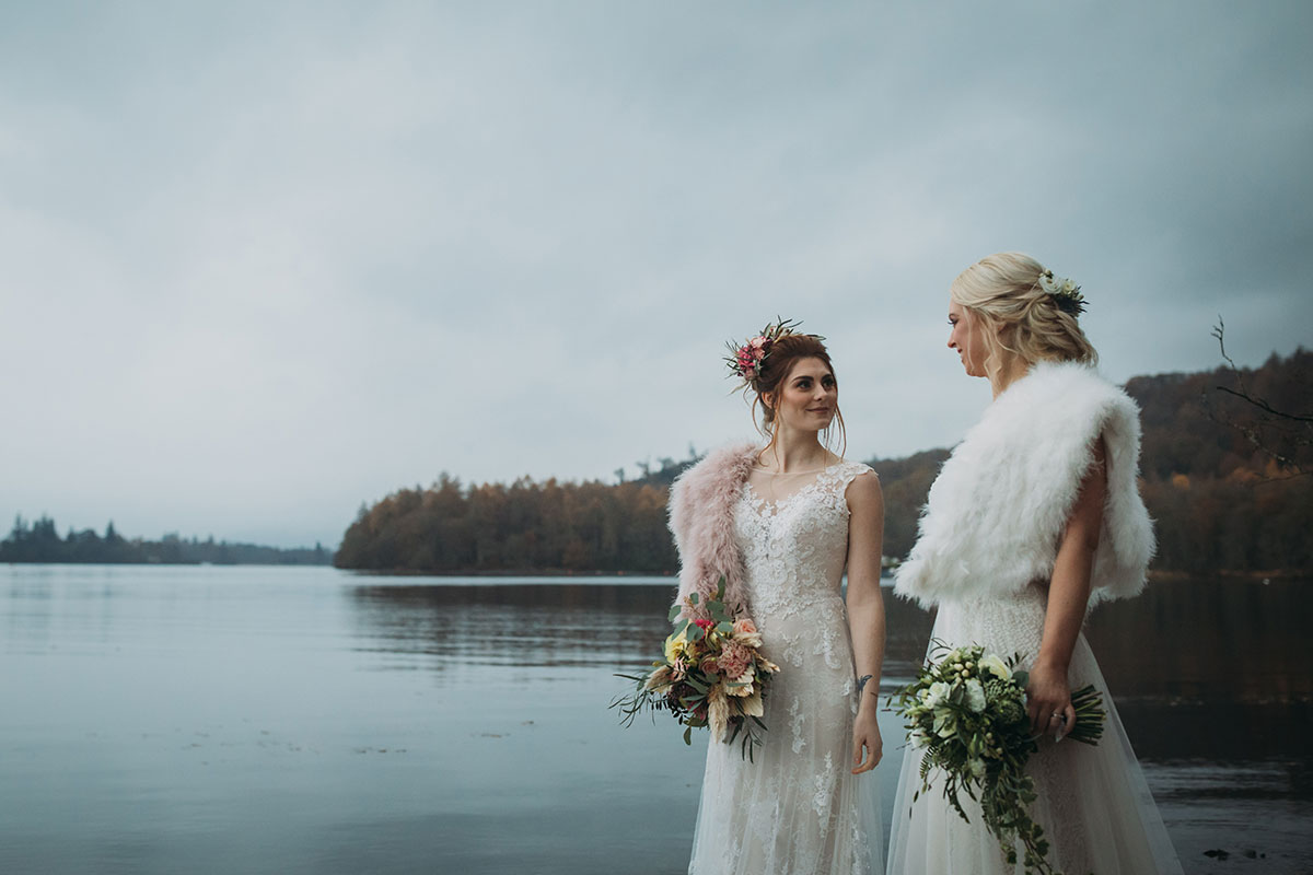 brides-wearing-faux-fur-shawls-by-waterside
