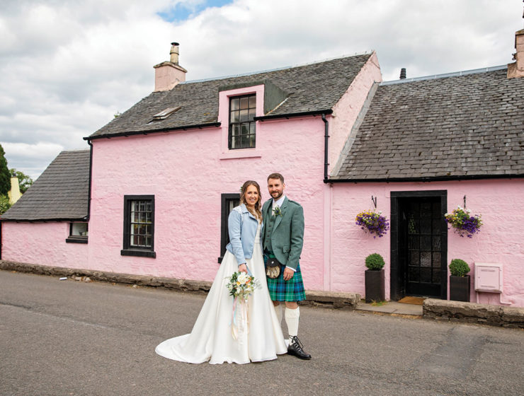 bride-and-groom-outside-pink-cottage-in-killearn