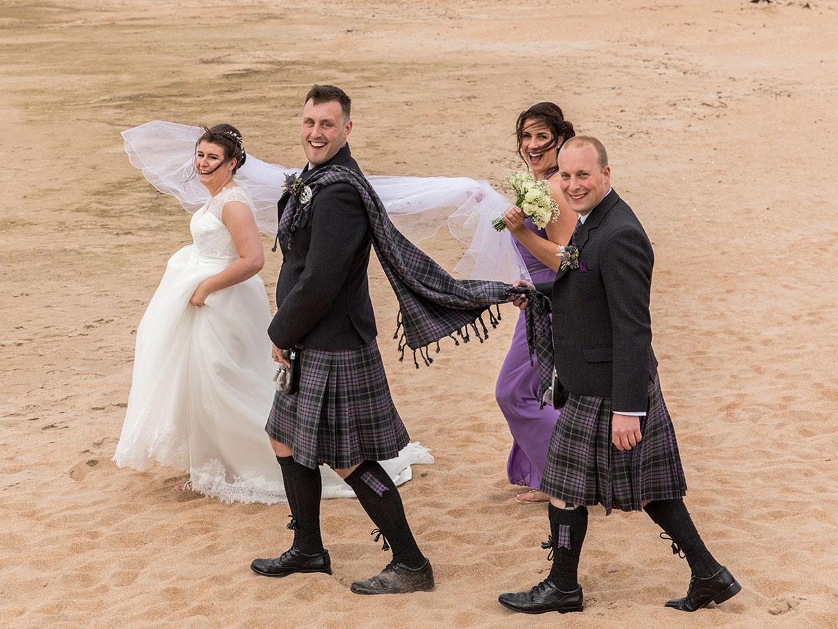 bridesmaid-carrying-brides-veil