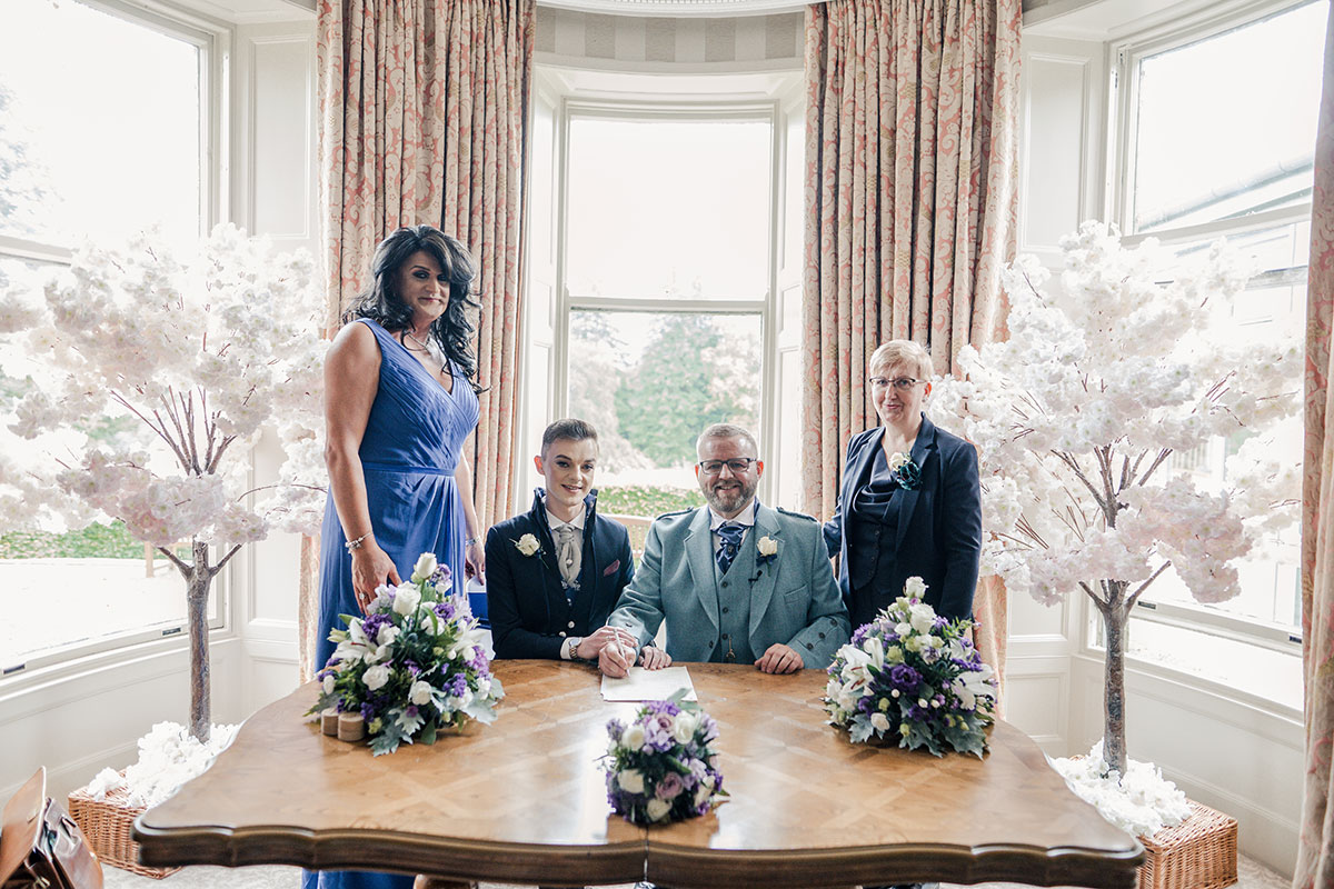 bridesmaid-grooms-and-celebrant-in-ceremony-room-signing-register