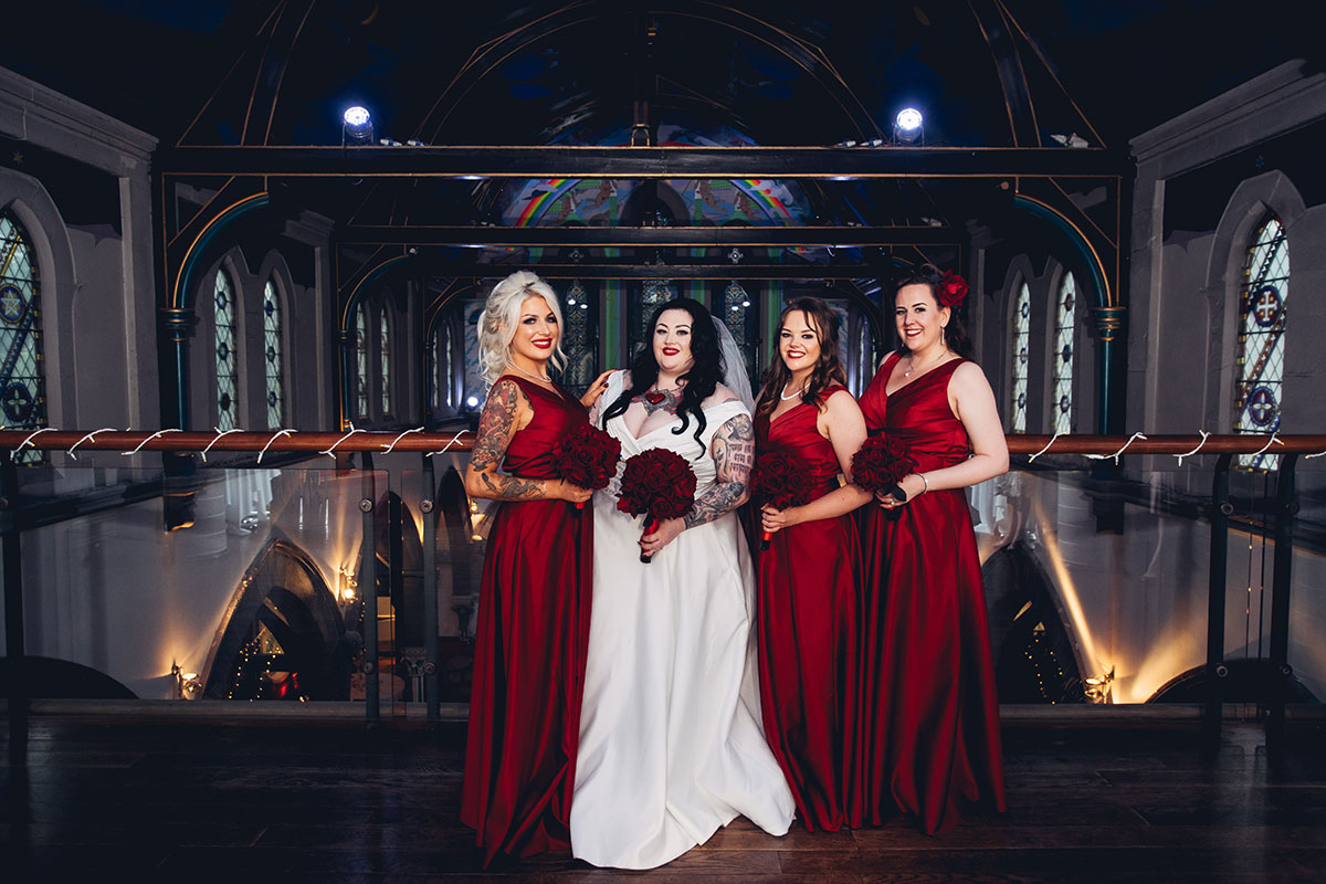 bride-and-bridesmaids-in-red-dresses