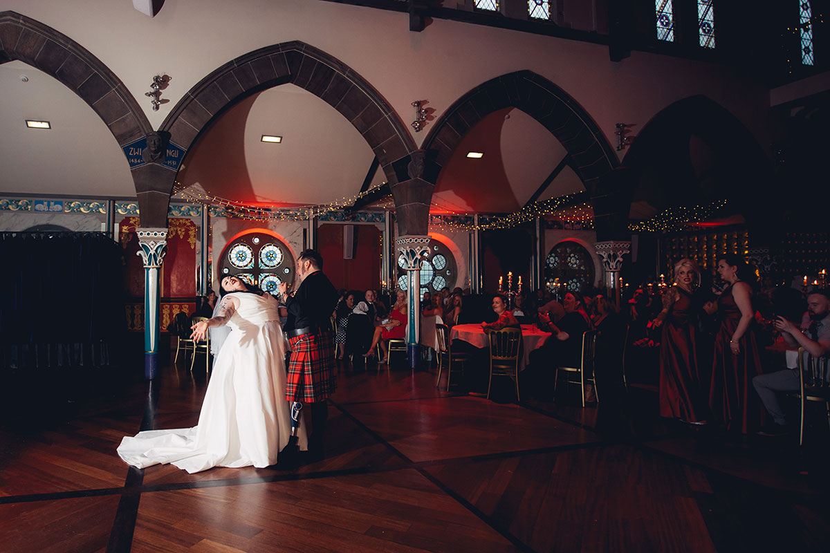 bride-and-groom-during-first-dance-on-dancefloor-at-oran-mor