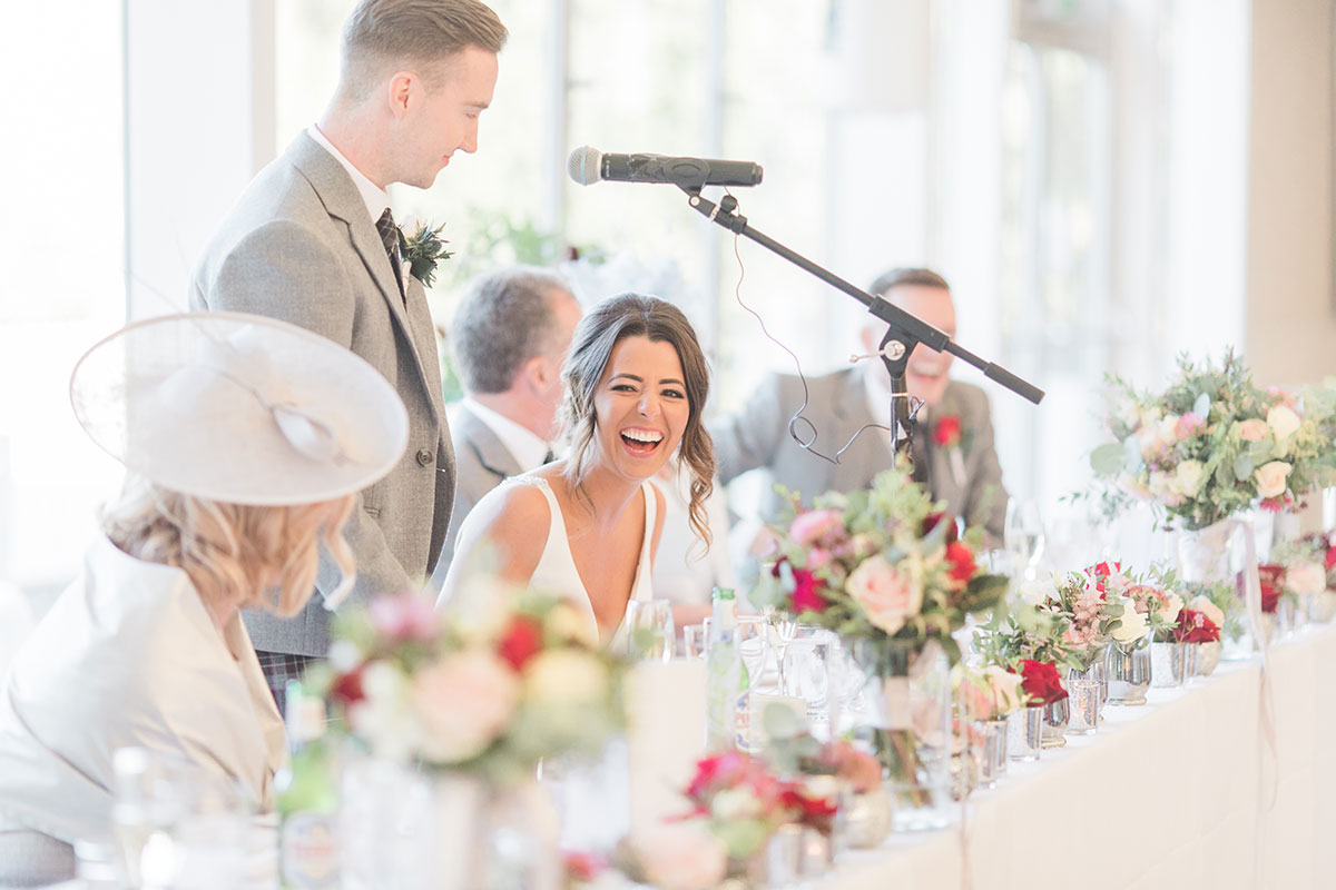 bride-laughing-during-speeches