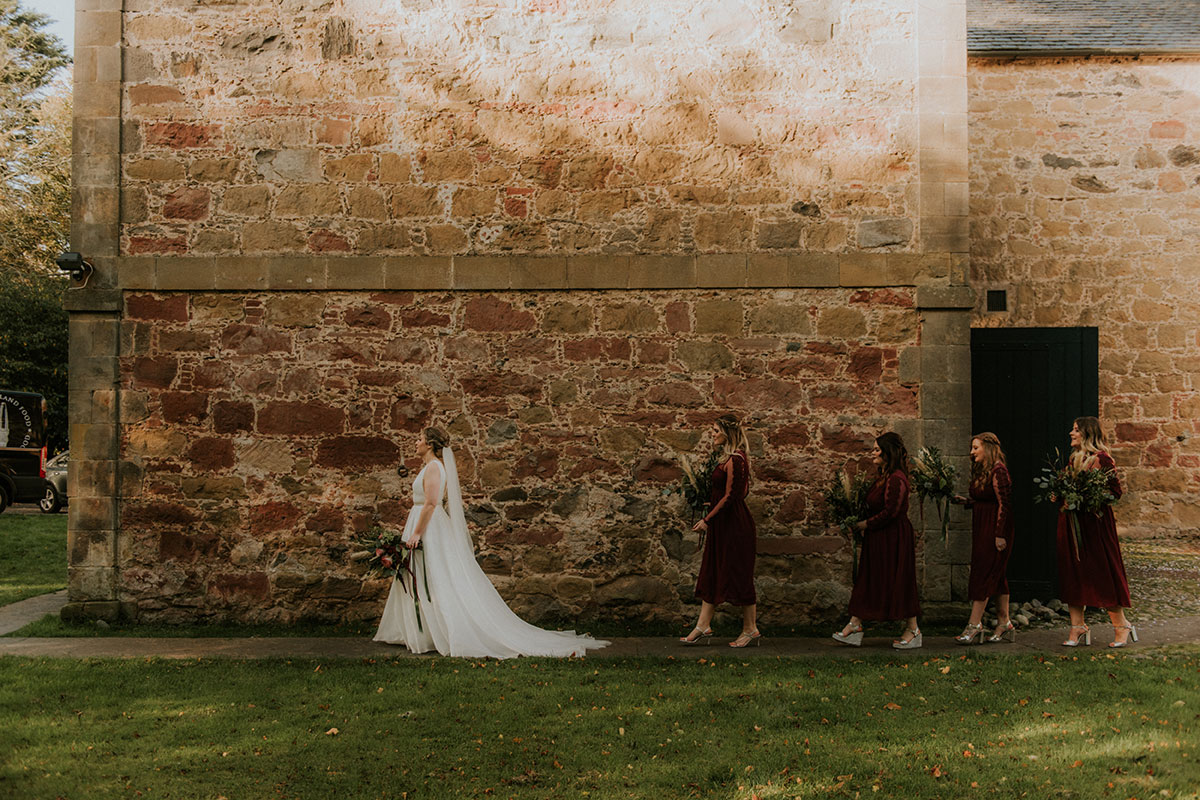 bride-and-bridesmaids-walking-to-the-ceremony