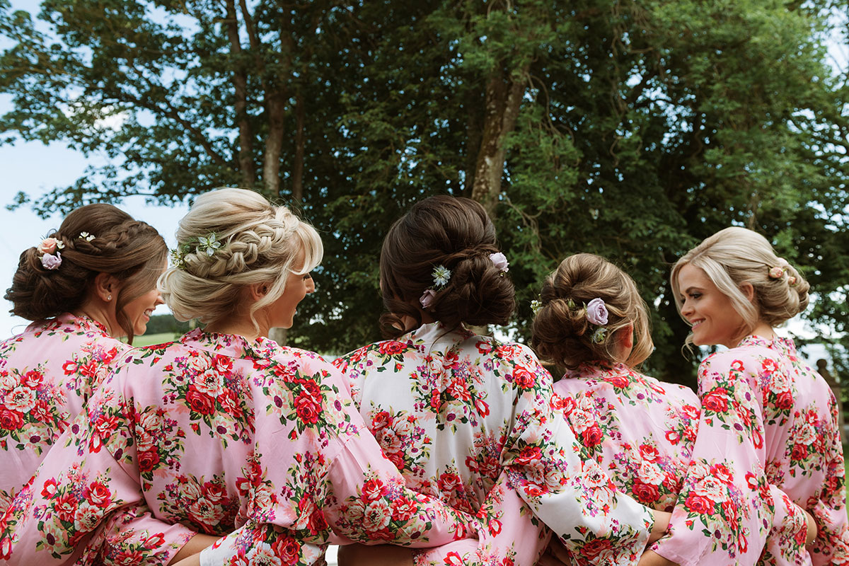 bride-and-bridesmaids-with-floral-robed-and-flowers-in-their-hair